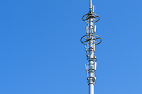 Stacked cellsite cellular base station antenna pole tower array
