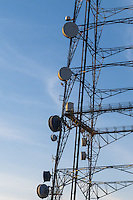 Microwave dish antenna on television broadcast transmission lattice tower at sunrise on Mt Coot-tha